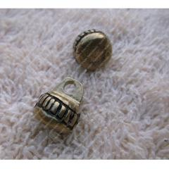 Brass button with a ball